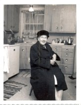 Image of PO.986.0054 - J Muriel Brown in her kitchen.
