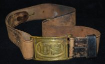Image of 052.004 - James Thomas Bussabarger's US military belt.  Wide leather belt with brass buckle clasp with US imprinted.  Used in connection with Civil War type uniform circa 1892-95. James Thomas Bussabarger was Peggy Westerlund's grandfather, his daughter was Mrs. H. L. Riley of North Bend.