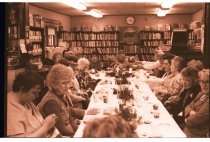 Image of 960.1980.12.13.01.03 - Large group of women in Duvall Library at dinner meeting.