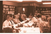 Image of 960.1980.12.13.01.04 - Large group of women in Duvall Library at dinner meeting.