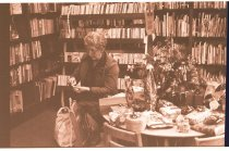 Image of 960.1980.12.13.01.06 - Woman in Duvall Library at dinner meeting.