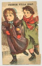 Image of 033.081.A-G - Advertising cards, assorted soaps. Assorted sizes, colored printed cards, torn from scrapbook, with information on back of cards obliterated. a. French vanilla soap- boy and girl skating on ice. Girl in purple coat, blue bonnet, red mittens; boy in green suit, red scarf, brown hat, red/ white striped stockings, ice skates with leather heels. b. Sweet home family soap, J.D. larkin & CO., little girl in white blouse and blue pinafore with blue sash, brown hair, round blue eyes, cupid-bow lips. Blue bows on shoulders. c. Acme soap, Best Bar Soap Made, Brown & Nichols, girl in pink dress with yellow yoke, wide blue sash, blue stockings, white shoes, yellow straw hat with flowers, picking apples from tree. d. Pure cocoanut soap, G.A. Shoudy, 2 little boys in ocean with green water and waves, sitting inside broken egg shell with 2 sails. pansy flower with green leaves hangs over side of boat. One boy waves blue hat. e. Pure Cocoanut Soap, G.A. Shoudy, ocean scene, green water, boy inside broken egg shell with 2 oars and single rose. Ship and light house in distance. f. Sweet home Family Soap, J.D. Larkin and CO., sepia tone picture of Gibson girl type girl appears in bubble, side view of face. g. Sweet home family soap, J.D. Larkin & Co., aepia tone picture of girl in bubble, Gibson girl type with flowers in hair and long hair flowing across shoulders. Large ring ear rings.  Received in 1979