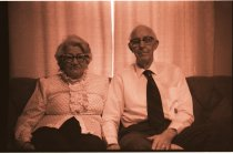 Image of 960.1980.12.13.01.17 - Elderly couple sitting on couch.