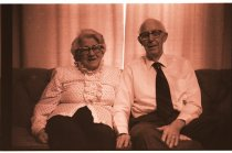 Image of 960.1980.12.13.01.18 - Elderly couple sitting on couch.