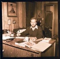 Image of 960.1982.02.08.02.02 - John Krona from Krona & Krona CPA's in Snoqualmie at desk.