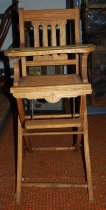Image of 021.001.A.B - Wooden baby high chair used by J Murie Brown when a baby. Her father had a furniture store. She was born in 1887.