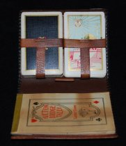 "Image of 015.049.A.B.C.D.E - Two decks cards in leather case and box, Masonic Emblem and name ""Otto Reinig."" Likely sold at Reinig Store in Snoqualmie. 