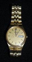 Image of 980.001 - Leo Kelley's gold retirement watch from Weyerhaeuser Timber Co.  Received at his retirement September 2, 1975.   Seiko.  Stainless Steel B. Water resistant. 2D7806. Base Metal St ASteel Back 7N43-8A39A1. B 1680E.  Seiko Quartz.  Weyerhauser Logo on face with date dial.  Watch is very typical of Weyerhaeuser retirement gifts. Dave Lake received on exactly like it when he retired in the mid 1980s.