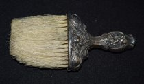 Image of 029.002 - Herb Parker's (North Bend settler) hat brush with silver handle. 