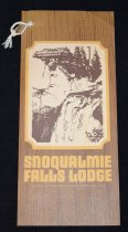 """Image of 014.035 - Menu to the Snoqualmie Falls Lodge.  Brown, wood- grained cardboard on front with picture of the Falls and Lodge in large center picture.  Back cover, yellow, with printed Legend of Snoqualmie Falls at the bottom. Brown Print. Double fold Menu. Honoring---59 birthday-- Boyd Graves and Orville Graves, owners. 6.5""""w x 12.5"""" long"""