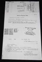 """Image of 030.299 - Statutory Warranty Deed (copy). 8.5x14"""" 4871699 Recorded Feb 5, 1958. The grantor P.F. Burns, a bachelor, for and in consideration of Ten Dollars in hand paid, conveys and warrants to Lester L.Burns and Minnie L. Burns, his wife the Real Estate: lots 13 and 14, block 13, plat of Fall City. There is a stamp on the deed that reads; sales tax lien paid. Feb. 5, 1958 and signed by the King County treasurer. There are stamps, similar to postage stamps. One is a tax on conveyances, for five dollars, one is a Documentary for five dollars, and a documentary stamp foor 50 cents."""