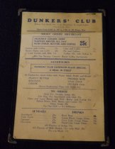 """Image of 145.110.a.b - Menu Card, Dunker's Club  a.  Cardboard menu printed on white card.  5-3/4"""" x 8-1/2"""".  Blue printing on white.  Front side has name in large diagonal letters in center.  Address:  1514 First Ave.                                Ben Marcus, Prop.                                G. M. Bensussen, Mgr.      Doughnut prices at top of front of card.  On other side is price list for SHORT ORDER BREAKFAST - SANDWICHES - TO ORDER - SUNDAES-DRINKS.  We are serving Crescent Brand Coffee Exclusively  b.  Menu card is enclosed by clear plastic front and back with leather edges.  Opens on one side only.  Metal corners.  Date and location unknown."""