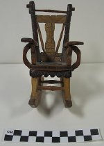 Image of carved miniature rocking chair - Carving