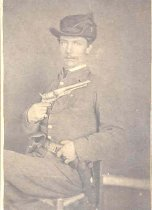 Image of Seated Soldier with Gun -