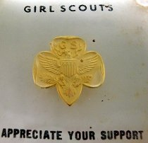Image of Detail view of Girl Scouts paperweight