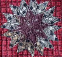 Image of Lone Star Quilt  made by Minnie Alice Young Sutton (detail or corner stor)