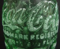 Image of Coca-Cola bottle (detail)