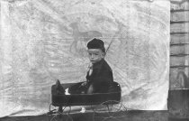Image of Infant in a Wagon