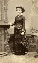 Image of Woman in Hat with Umbrella -