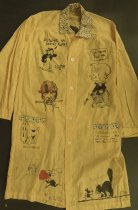 Image of [Yellow linen smock decorated with drawings of cartoon characters] - Biedermann, Louis, 1874-1957