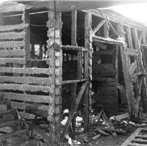 Image of 2009.13.0162-F - FIRE DAMAGE TO THE FISHERMAN'S NET STORAGE AND LOCKERS AT BERTH 79, RESULTING FROM THE FIRE OF DECEMBER 10, 1938. THIS VIEW WAS TAKEN UPSTAIRS ON THE SOUTH SIDE OF THE SOUTH CORRIDOR.