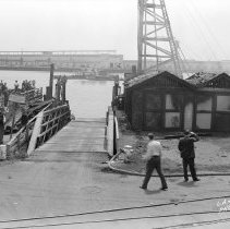 Image of 2009.15.0831-G - GENERAL VIEW, SHOWING THE TEAM FERRY LANDING AT BERTH 89, AFTER IT HAD BEEN TEMPORARILY REPAIRED, FOLLOWING A PARTIAL DESTRUCTION BY THE FIRE OF MAY 14, 1941.