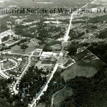 Image of AE 0647 - Aerial view over shopping center on Arlington Boulevard near the Kamp Washington area.