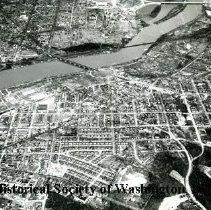 Image of AE 0075 - Aerial view north from Anacostia over the Sousa Bridge East Capitol Bridge in the background.