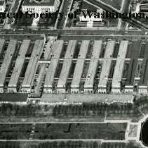 Image of AE 0100 A - Aerial view north from the Reflecting Pool over the Navy Department and Munitions Buildings.