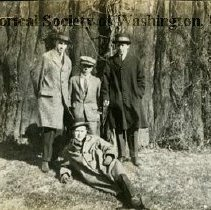 Image of AL 011.04A - Unidentified men posed at the foot of the Redwood Tree House on the Mall.