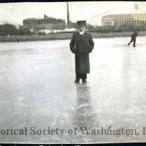 Image of AL 011.07B - Man standing on ice-covered Tidal Basin.