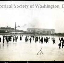 Image of AL 011.07E - Men standing on ice-covered Tidal Basin.