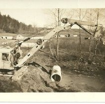 Image of Excavator setting a culvert