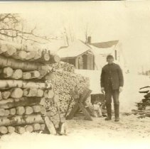 Image of Charles Dyke 1940s at woodpile