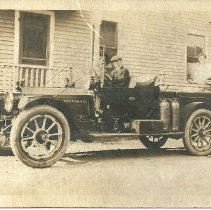 Image of Postcard, unidentified men on fire truck