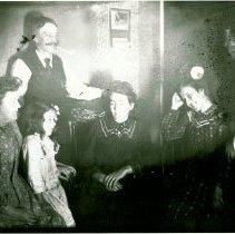 Image of Family inside house in Ligonia