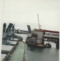 Image of Casco Bay Bridge, tanker going through draw bridge