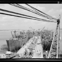 Image of Ocean ships tied up at the outfitting pier, Todd-Bath Iron shipyard