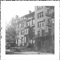 Image of [Portion of #70 Pierrepont Street (far right), then (right to left) # 76, #80, and Hotel Palm at corner of Henry Street (obscured by foliage).] - John D. Morrell photographs
