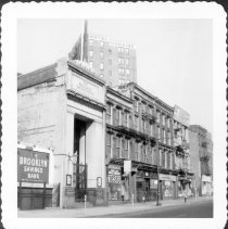 Image of [The Brooklyn Savings Bank (#300 Fulton Street) (left.) George Levin - Used and New Office Furniture (#298 Fulton Street) (center), also called H & H Desk Co.] - John D. Morrell photographs