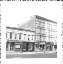 Image of [At left is a vacant bar & grille restaurant for sale.] - John D. Morrell photographs