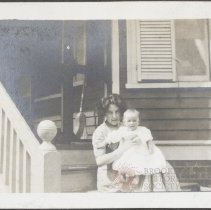 Image of [Woman with baby on porch] - Burton family papers and photographs