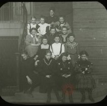 Image of [Group portrait of Miss Stanton and girls] - Emmanuel House lantern slide collection