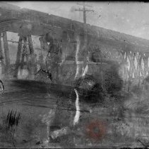 Image of [Elevated railroad bridge with train in transit] - William Koch glass plate negatives
