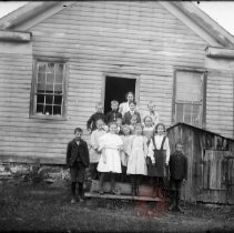 Image of [Woman and children in front of frame building] - William Koch glass plate negatives