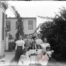 Image of [Group portrait of 11 children in a yard] - William Koch glass plate negatives