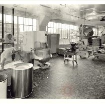 Image of [Industrial Baking Equipment and Worker at Drake Bakeries Factory, Clinton Avenue] - Drake Bakeries photographs