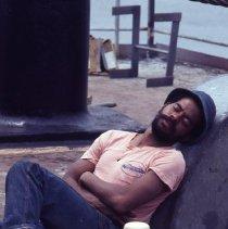 Image of [Seatrain worker taking a nap] - Frank J. Trezza Seatrain Shipbuilding collection