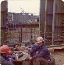 Image of [Seatrain workers on break] - Frank J. Trezza Seatrain Shipbuilding Collection