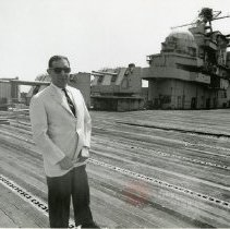 Image of [Man in white suit jacket and sunglasses at Brooklyn Navy Yard] - Anthony Costanzo Brooklyn Navy Yard collection